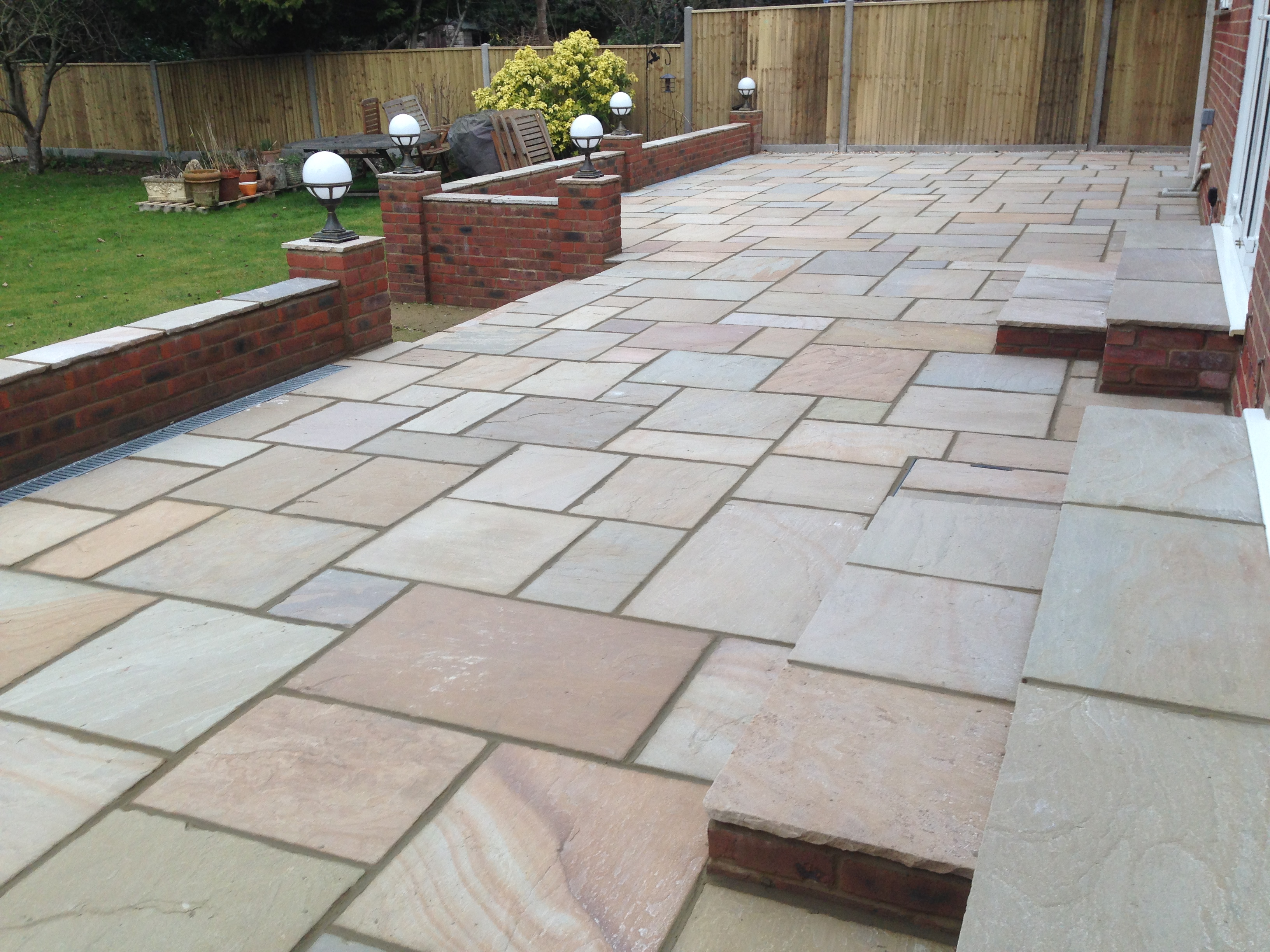 Sandstone Patio, Retaining Wall and Lighting - Winchester Landscapes